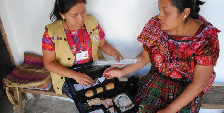 A family planning user and a health promoter discuss contraceptive methods in El Quiché, Guatemala. © 2014 Haydee Lemus/PASMO PSI Guatemala, Courtesy of Photoshare